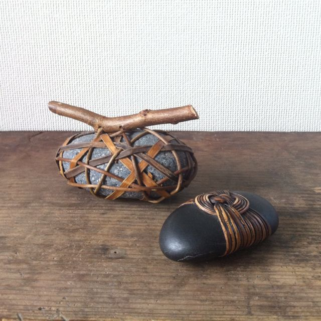 Pebbles weaved with rattan by Deloss Webber. A long time ago present from dear friends just now remembered the name of the artist!!
