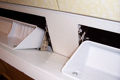 tip out trays made from the fake drawers under sinks...hide dish sponge & drain plugs