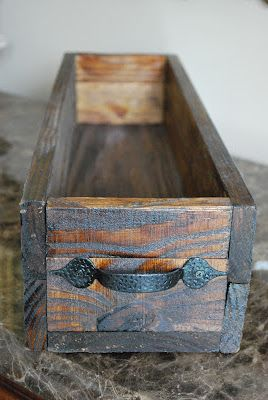 Use an inexpensive farm style cabinet door pull as a handle for a simple homemade bos. Love it.