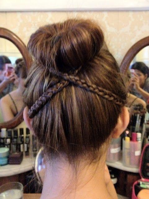 Criss-crossed braids and bun. Cute.