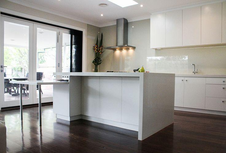 eat.bathe.live :: Hampton residence by eat.bathe.live - kitchen with bifold doors onto deck