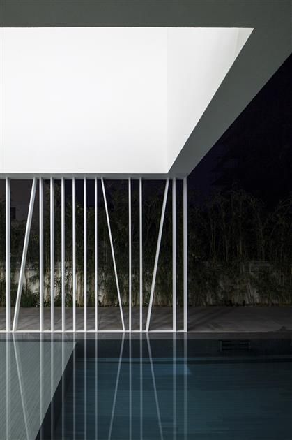 Delicate claustra wall + pool.