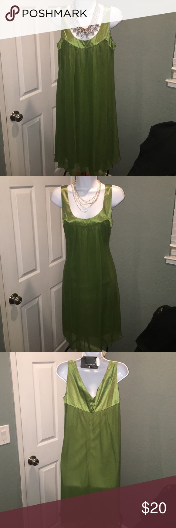 Kiwi green dress Satin lined scoop neck and flowy silk shell screams for a hot pair of heels and you're good to go. Worn once for a couple of hours. Can be dressed down for a daytime event with a belt. Dresses