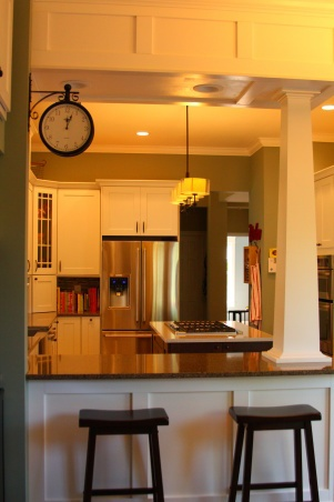 Kind of like the straight peninsula with column in kitchen.