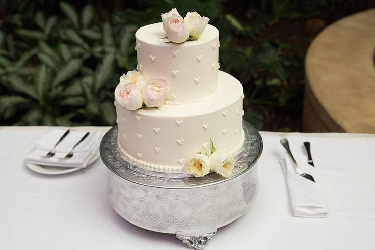 Fresh flowers add a touch of elegance to this wedding cake.