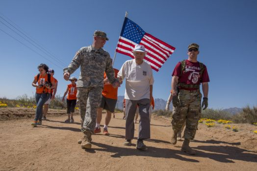Retired U.S. Army Col. Ben Skardon, 99, a survivor of the Bataan Death March, walks in the annual Bataan Memorial Death March at White Sands Missile Range, accompanied by two Army medics, March 19, 2017. This was the tenth time Skardon walked in the march, and he is the only survivor of the real Bataan Death March who walks in the memorial march. (Photo by Ken Scar)