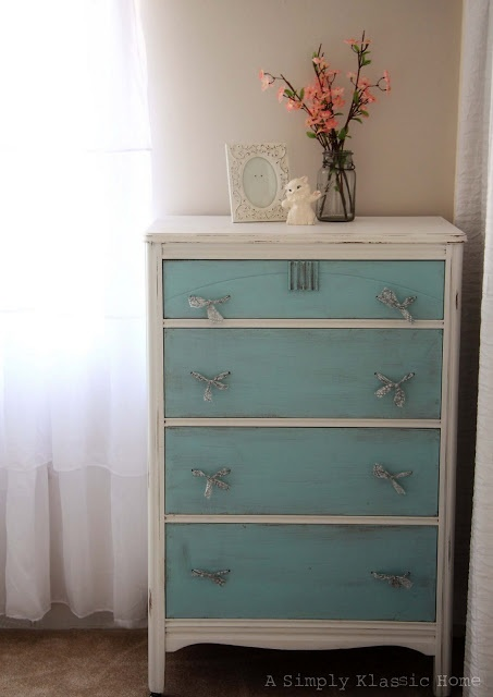 Two toned painted dresser with fabric handles. I wouldn't use the fabric handles, but I love the two tone look.