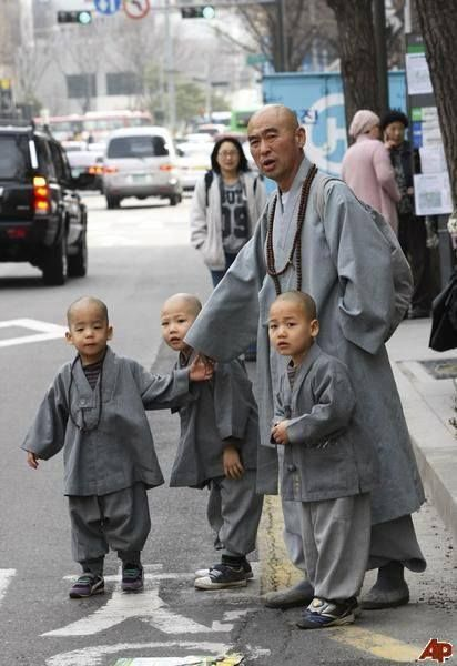 Novice Buddhist monks and their teacher wait to take a taxi in downtown Seoul, South Korea  https://www.facebook.com/Korea.Update