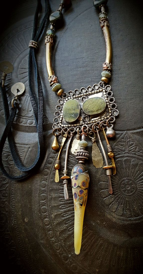 THIS LISTING IS RESERVED FOR A SPECIFIC CUSTOMER. stunning vintage Kuchi pendant with green turquoise inlay, below is an assortment of hammered brass and silver daggers with added silver beads,brass discs, bells and slab charms. In the center is an artisan made lamp work dagger that is GORGEOUS!! ♥, above is an assortment of Czech glass beads with a Picasso finish including old glass rounds, roundels of Roman Glass, silver tube spacers, brass daisies and bead caps with long old tubes of…