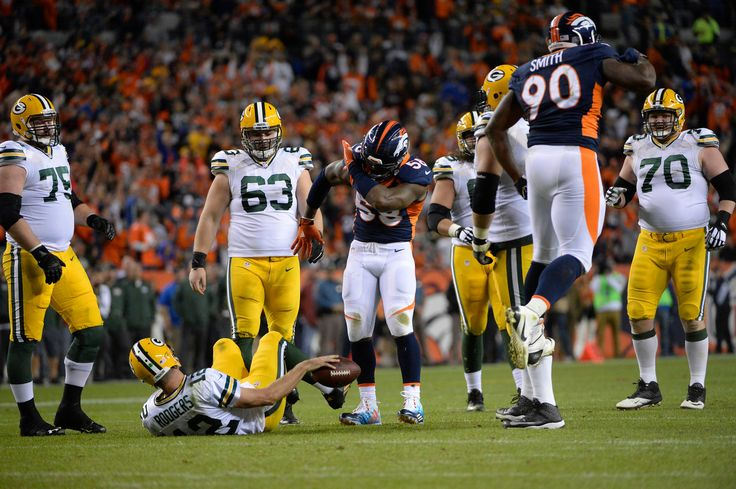 . Von Miller (58) of the Denver Broncos does his sack dance while Aaron Rodgers (12) of the Green Bay Packers is still on the ground. The Denver Broncos played the Green Bay Packers at Sports Authority Field at Mile High in Denver, CO on November 1, 2015. (Photo by AAron Ontiveroz/The Denver Post)