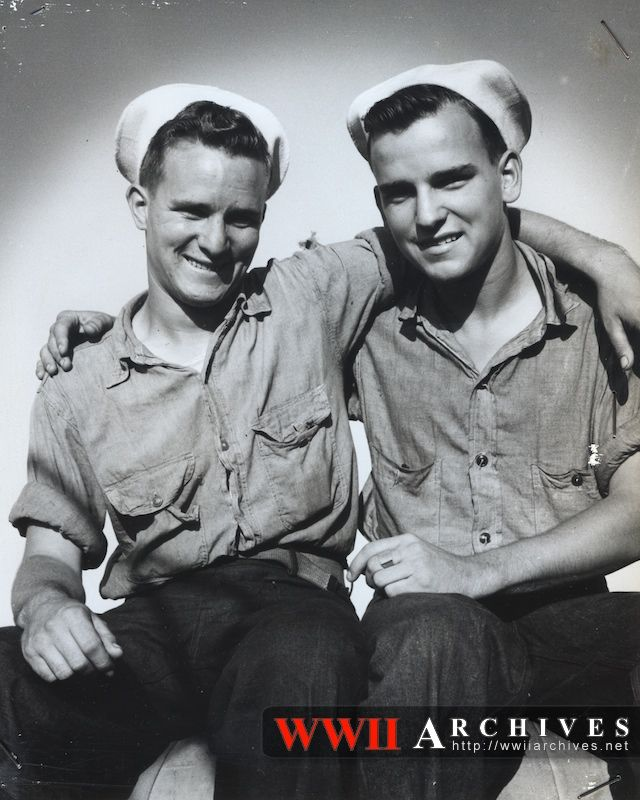 These two brothers met for the first time since they enlisted when they both participated in the invasion of Salerno, Italy. They are Coast Guardsmen Joseph H. Blue, left, and Aloysius Blue, U.S. Navy, of Washington, D.C. The Coast Guardsman is serving aboard a combat transport and his brother is a member of a Navy beach party.: Ii Photographers, Wwii