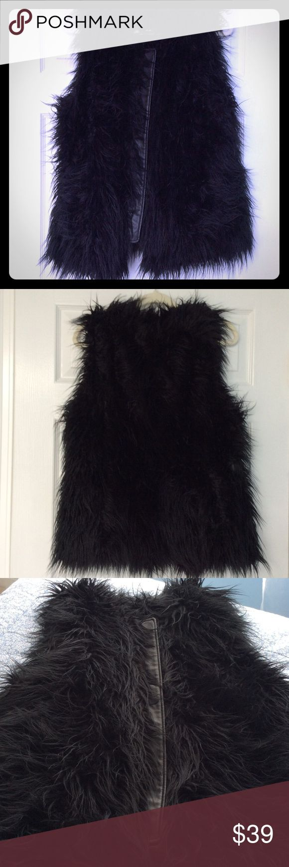 INTERNATIONAL CONCEPTS FAUX FUR CHER VEST LONG BLACK FAUX FUR VEST WITH LINING. HAS A HOOK AND EYE CLOSURE AT THE TOP AND FAUX LEATHER RUNNING DOWN THE MIDDLE FRONT. L GOOD CONDITION. BRING YOUR INNER CHER OUT! INC International Concepts Jackets & Coats Vests
