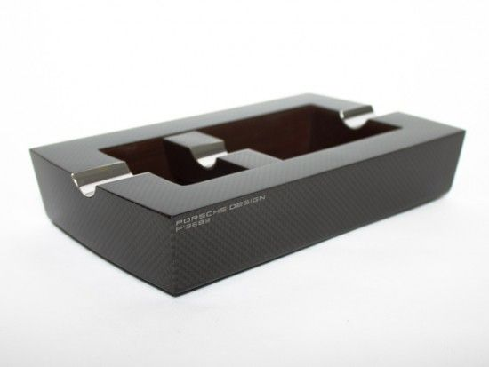 Modern twist on a cigar ashtray by Porsche Design, featuring a real carbon fiber exterior.  $700  http://store.carbonfibergear.com/porsche-design-carbon-fiber-ashtray