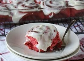 Ooey gooey red velvet-flavored breakfast rolls topped with cream ...