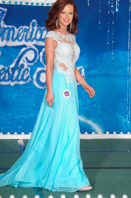 Brooke Hodgson, America's Majestic Miss National Ambassador, looked like an auburn Queen Elsa in this stunning ice blue evening gown at the America's Majestic Miss Pageant.