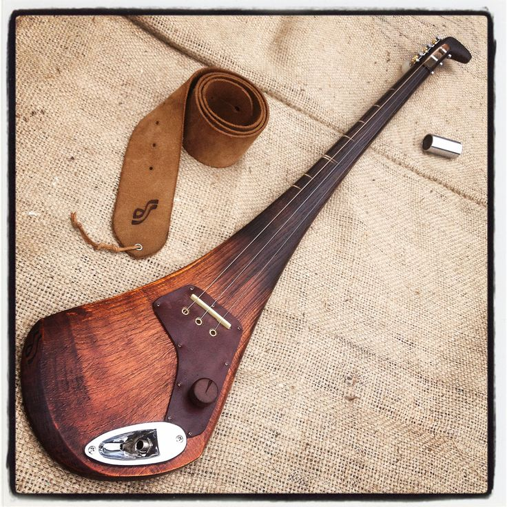 Electric slige guitar by DaShtick. Les Hurl - three-string guitar made out of a hurley stick. Celtic diddley bow. Cbg