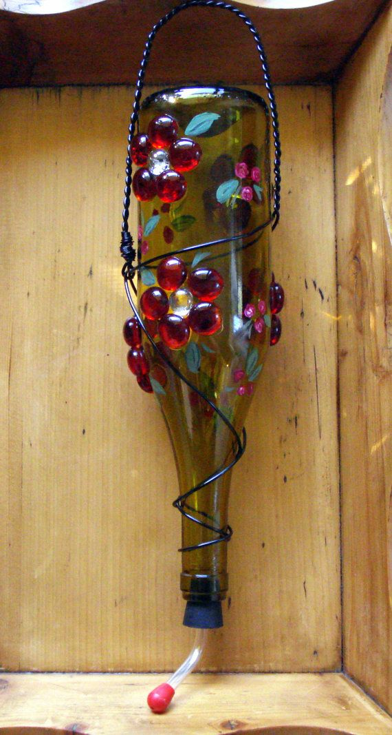 wine bottle hummingbird feeder...so much prettier than the usual ones