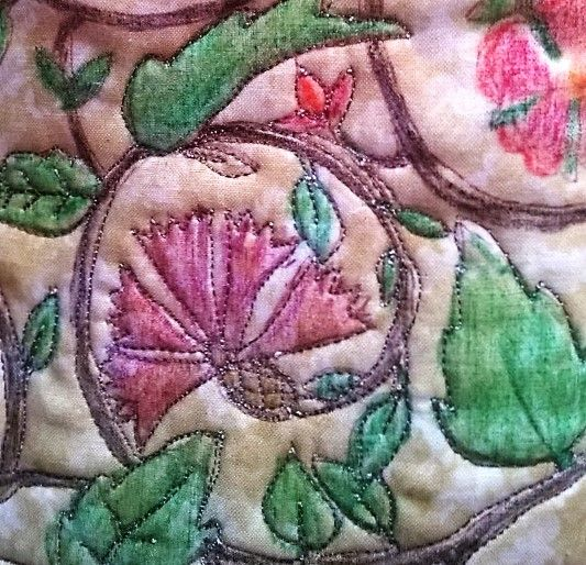 Up close, design was drawn, crayons to colour in then outlined and quilted