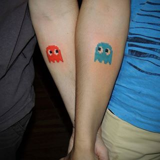 This perfect Pac-Man pairing.   23 Geeky Couple Tattoos That Are Beyond Perfect
