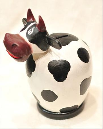 This adorable cow money bank is hand crafted in Bali and is not mass produced or factory made.