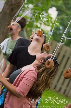 Minute to win it Donut game!  We did it on   string 2 at a time with someone (a helper) holding the string!