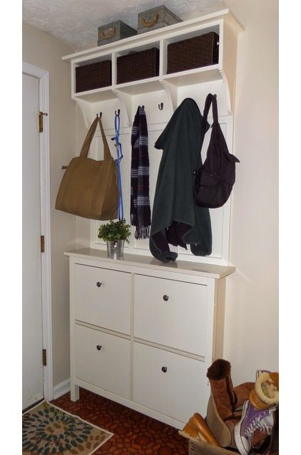 "There isn't a mudroom,"" says kraesmom. ""But we have made the most of our small entry with an Ikea shoe cabinet, some trim and a cabinet that I custom built to coordinate."""