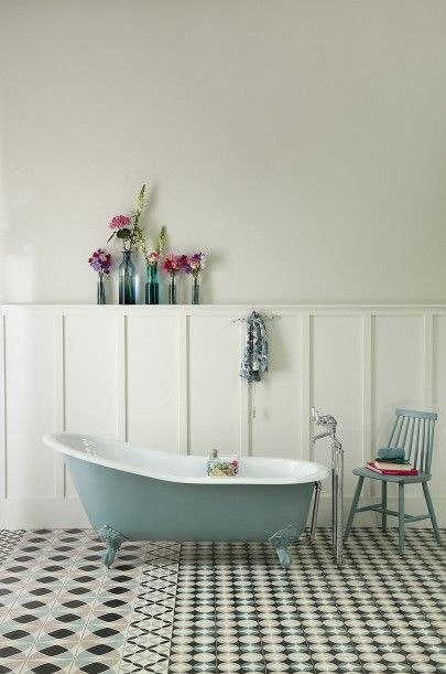 The Dawlish Victorian Slipper Cast Iron Bath looks fab on a patchwork of patterned tiles designed exclusivley for the Cast Iron Bath Company by Ann Louise Roswald