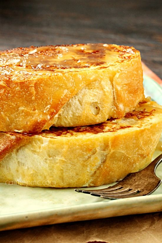 Pumpkin Cream Cheese Stuffed French Toast a pillow of buttery bread that's crispy on the outside and filled with a luscious, creamy pumpkin flavored cream cheese inside.