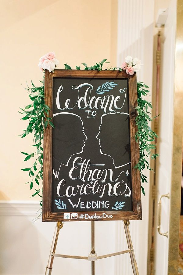 Rustic glam wedding chalkboard sign with greenery and silhouettes