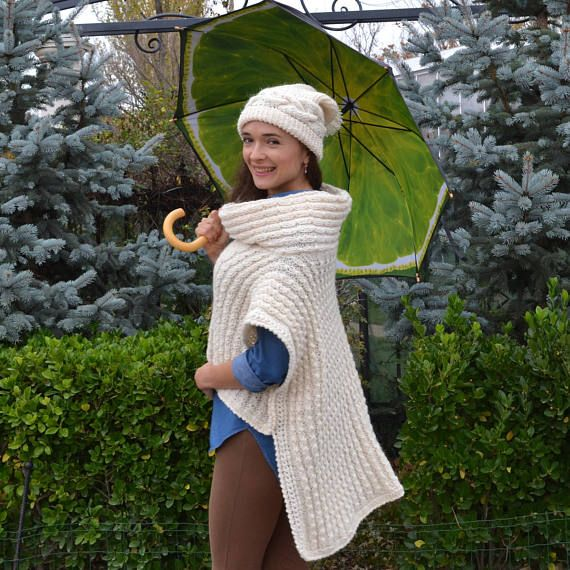 Women's Cape .Beanie as a Gift .Knitted Cape Poncho . #Women's_Cape #Beanie_Gift @Knitted_Cape @Poncho_Cape @White_Cape @Poncho_Wrap @Cape_Coat @Cape_Jacket @Wool_Cape @Christmas_Gift @Winter_Cape @Oversazed_Cape @Capelet