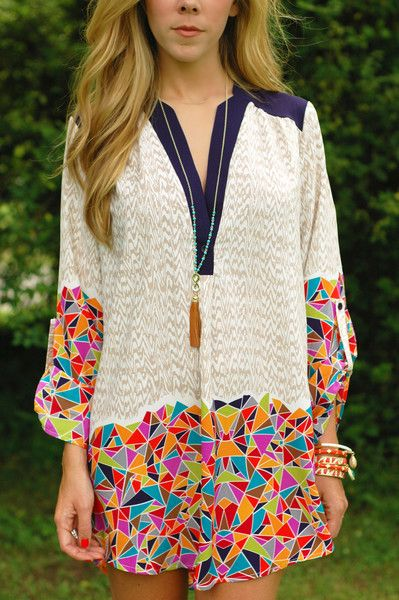 Love this combination of solid with fun prints and then the detailing around the neck.   Get fun with your prints!