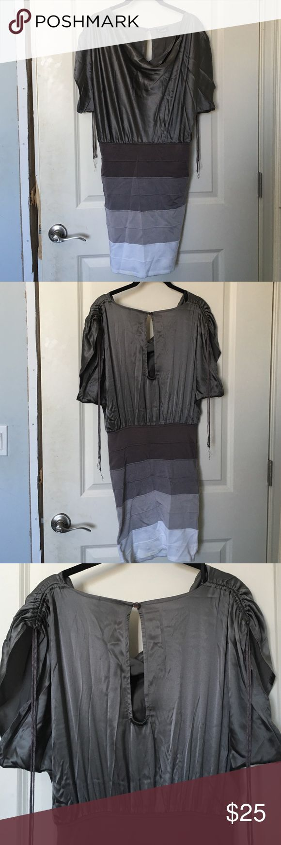 bebe Silk Silver Ombré Bodycon (Kardashian) Bebe Kardashian dress--- Silver with variations of gray for gradient-slendering effect, bandage style. Bodycon skirt rises to a high waist, with a draped silk top and gathered tied at the shoulders. Tried on at store but never worn. Will take best offer bebe Dresses Mini