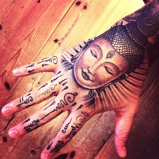 Buddhist hand tattooi dont see myself getting this but howwww sickkk