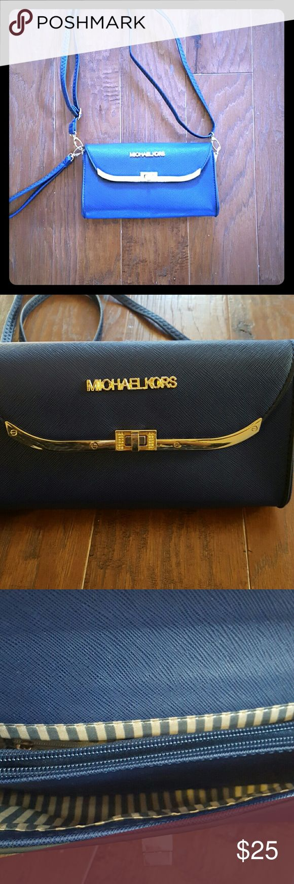 Designer Fashion Handbag on Navy Bag reads Michael Kors.  I can not guarantee the aunthenticity of the name brand, which proce reflects.  It's super cute though and in brand new condition. Bags Shoulder Bags