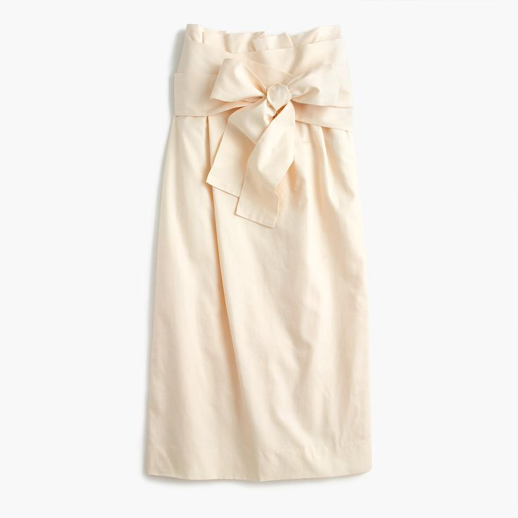 This skirt has the perfect fit, thanks to a discreet elastic waist that's hidden by a dramatic wraparound sash. Our designer recommends pairing it with slim tops to really accentuate however you choose to tie it (bow, half-bow, knot, etc.). Sits above waist. 30 long. Falls below knee. Cotton. Lined. Machine wash. Import. Online only.