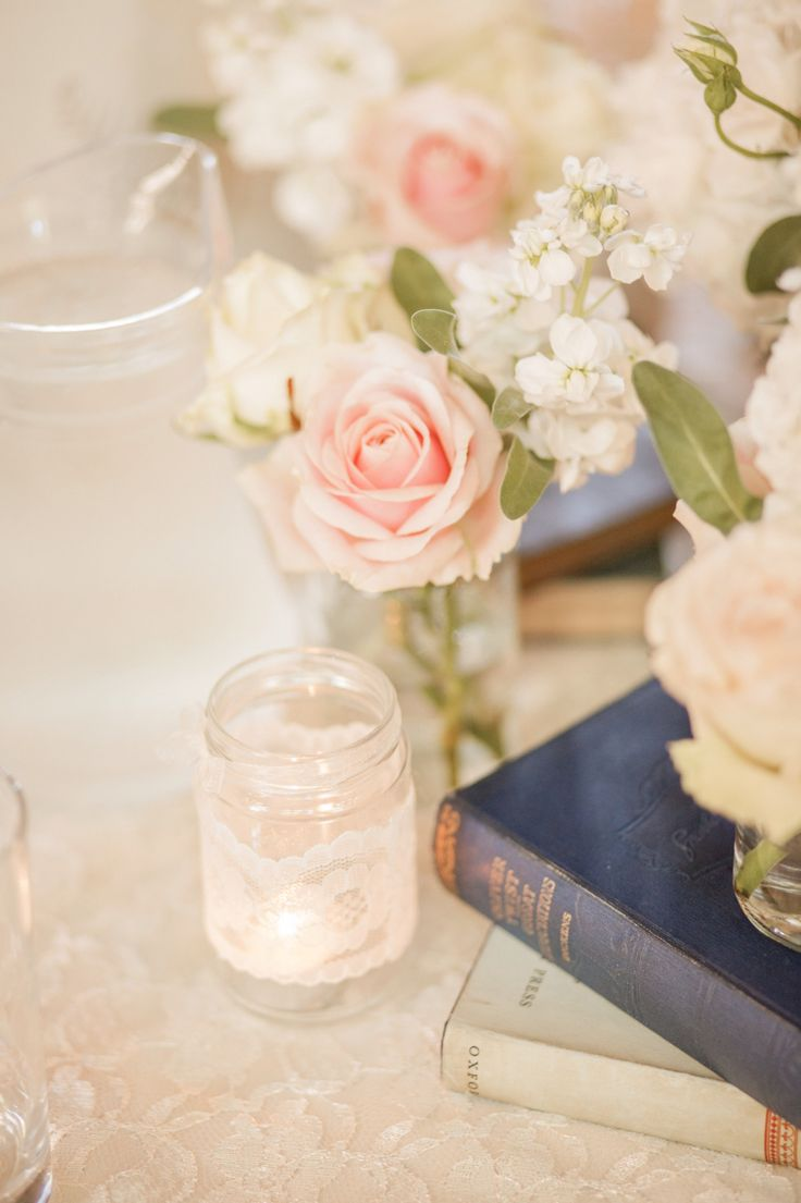 Vintage books, jars with lace, flowers for our centre pieces ❤️