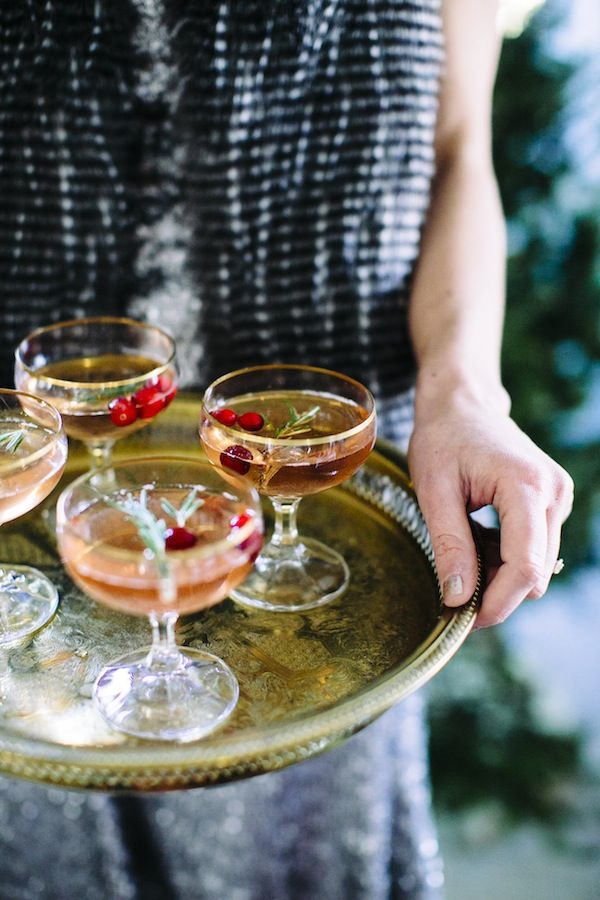 5 Holiday Hostess Tips - Instead of having a full bar, make one signature cocktail and then have an assortment of red + white wines and beer.