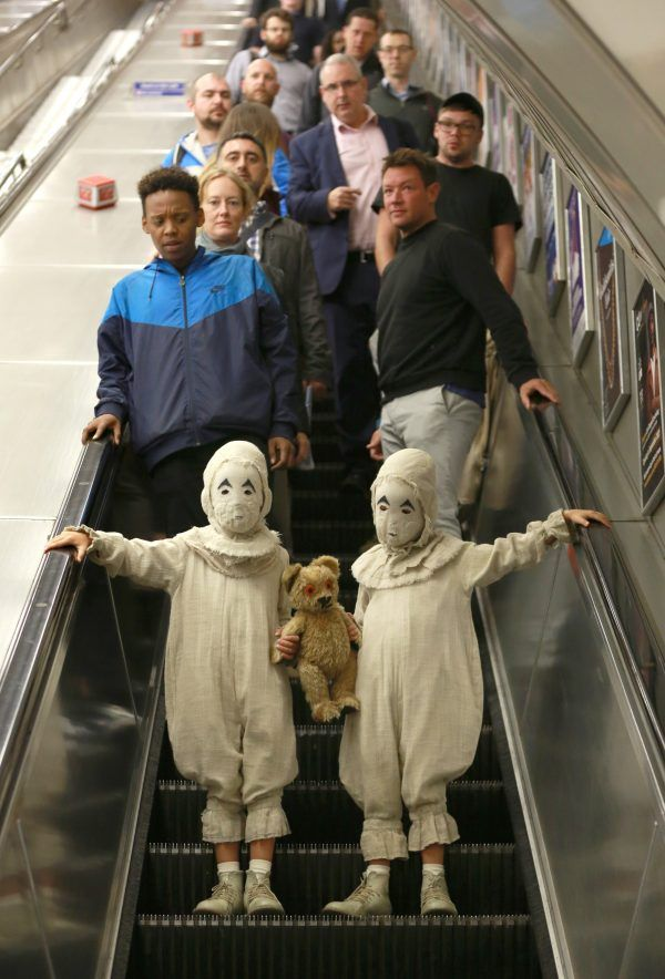 EDITORIAL USE ONLY Actors dressed as The Twins from the new Tim Burton film, Miss PeregrineÕs Home for Peculiar Children, travel on the London Underground ahead of the launch of the new movie. PRESS ASSOCIATION Photo. Picture date: Monday September 26, 2016. In the movie, which is released in the UK next Thursday 29th September, The Twins are speechless, wear masks that obscure their faces and have a hidden peculiarity that only comes to light in the most dangerous situations. Photo credit…