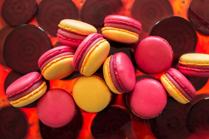 Macarons with white Valrhona chocolate ganache, passion fruit pulp and beetroot.