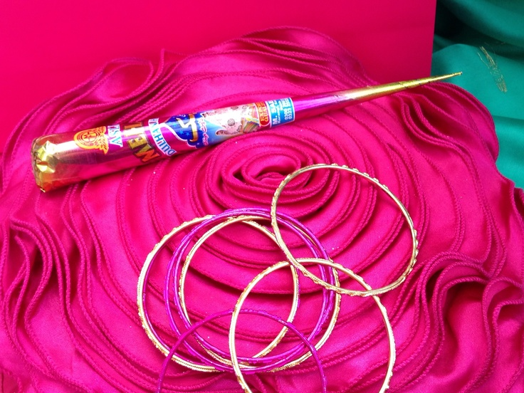 Henna cone with bangles, preparation for a Mehndi party by www.fuschiadesigns.co.uk.