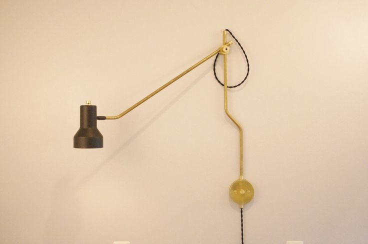 This 180 Degree Swivel lamp is made and designed by us with raw brass. Lamp takes a standard sized e26 light bulb. You can freely adjust with one hand the arm and shade. The shade swivels 360 degrees and the swing the arm freely moves 180 degrees.   eBay!