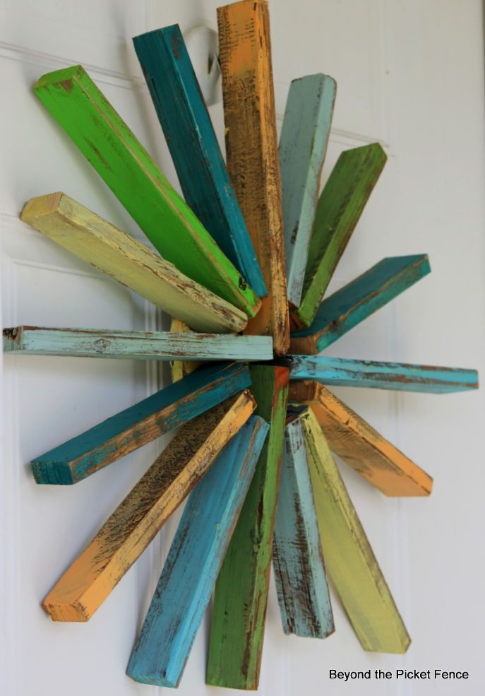 Give your porch a mini makeover with this colorful reclaimed wood wreath.