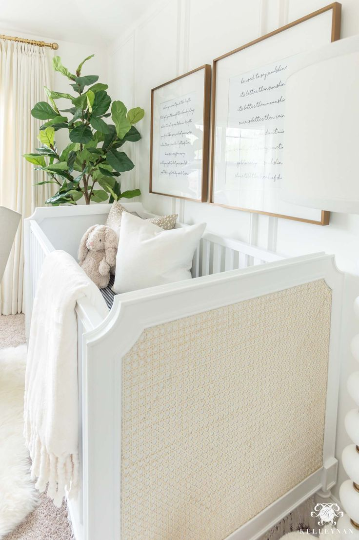White and cane Serena and Lily crib, fiddle leaf f…