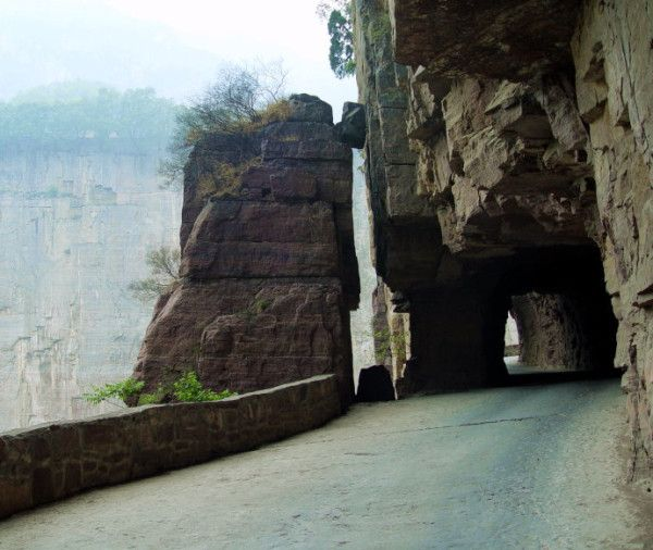 The Guoliang Tunnel: One of the World's Scariest Roads..13 farmers took 5 years to carve the tunnel by hand. http://www.visiontimes.com/2015/03/04/the-guoliang-tunnel-one-of-the-worlds-scariest-roads-pics-videos.html