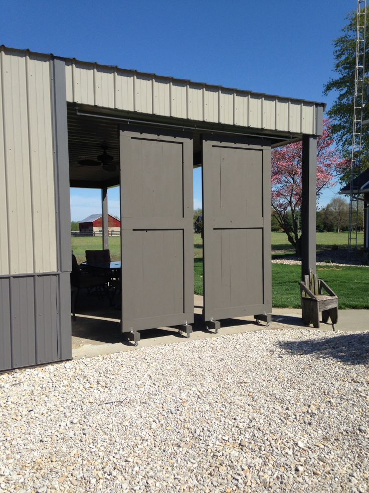 My husband just made these sliding barn doors for our for Pole barn sliding door plans