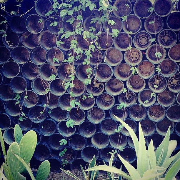 Wall from old plastic plant pots