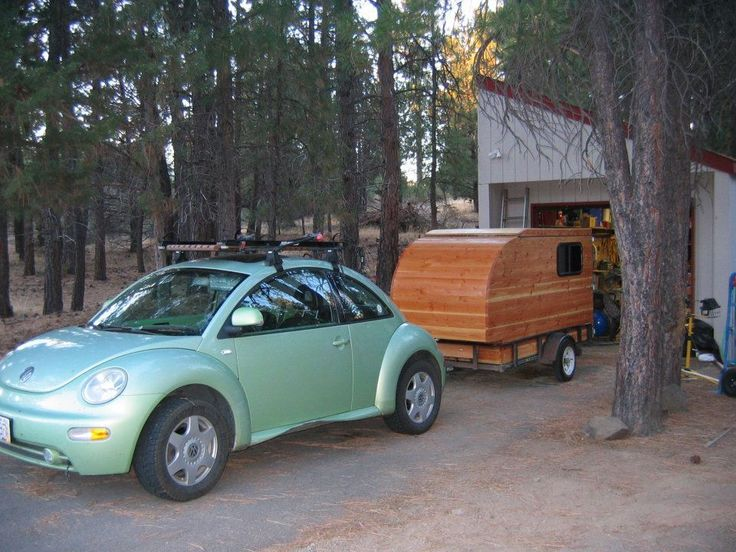 Kleine Cabine, Dutch for Little Cabin.  You are looking at a one-of-a-kind Douglas fir camper, pop top with ALL solid wood.  Features are:  50 ft RV cable, 2-6 volt golf cart batteries, 50 Watt solar panel, upper cabinet space with storage under the bed, kitchenette in rear door with two door cabinet, counter top and drawer. There is a small 300 Watt inverter to give you AC for computer, lights, music, and phone charging. Length is 10 ft, width is 4 ft, height is 4....