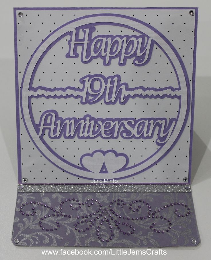 An anniversary card made with a cut file, that I designed on the Canvas site for my Scan N Cut machine. The photo isn't the best as I took the picture at night. There's a lot of sparkle that doesn't show in the photo. :)