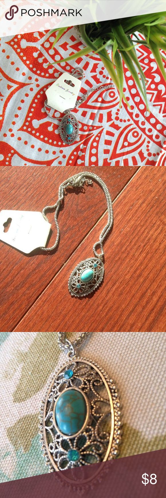 Necklace with the faux turquoise pendant Shiny silver colored necklace with a turquoise looking false stone and teal gems. Never worn. Chain is included. Jewelry Necklaces