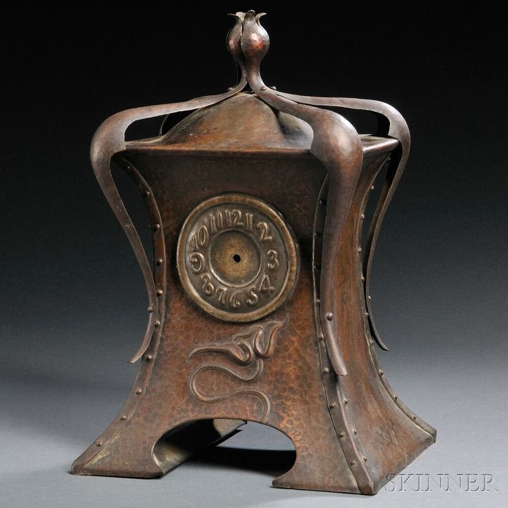 English Arts & Crafts mantle clock, hammered copper, repousse and riveted construction.